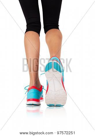 Detail of a woman legs running on a white background..