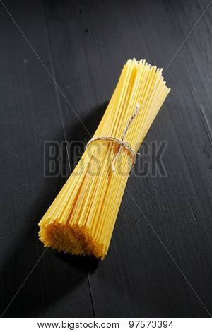 Raw pasta on black table close-up