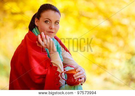 Girl Relaxing In The Autumn Park Enjoying Hot Drink