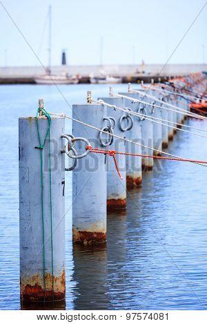 Row Of Metal Bollards On The Dock