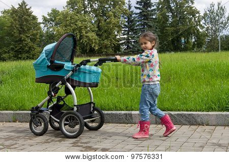 little girl walking with stroller