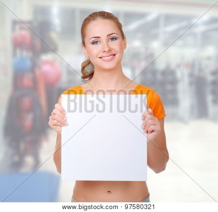 Young sporty woman at fitness club