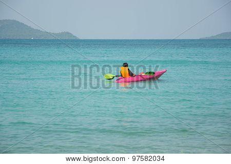 Men Paddle Kayak On The Sea