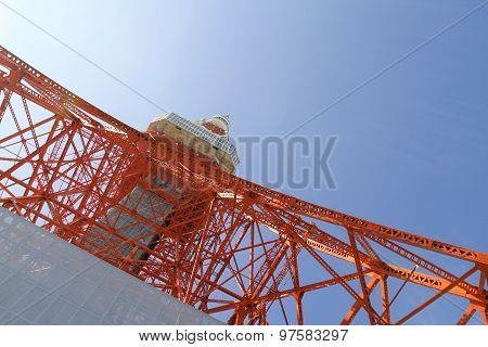 Tokyo TV tower from below against blue sky