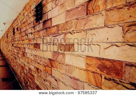 perspective of a red brick wall