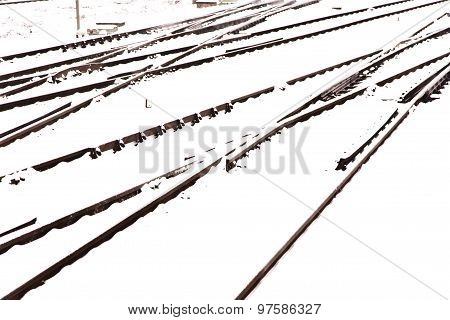 Railroad Tracks In Winter With Snow