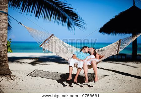 Romantic Couple Relaxing In Hammock