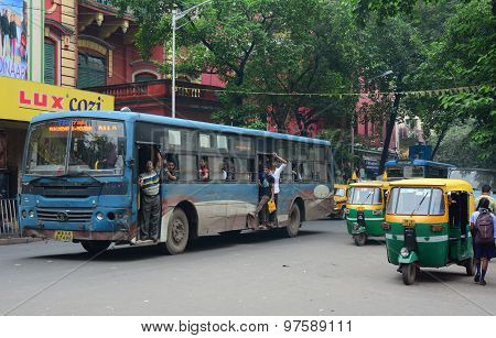 Vehicles And People On Street In Kolkata, India