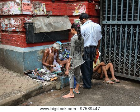 Shoe Shiner Does His Job At Street Of Kolkata
