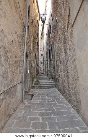 Narrow stony street in Tuscany town