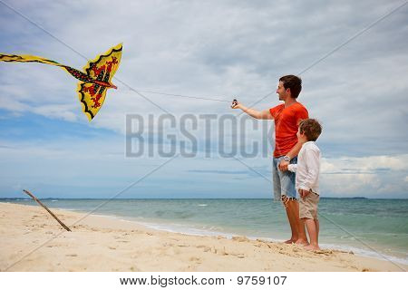 Dad And Son Flying Kite
