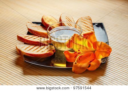 Toast with honey and flower