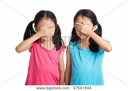 Asian Twins Girls Close Their Eyes