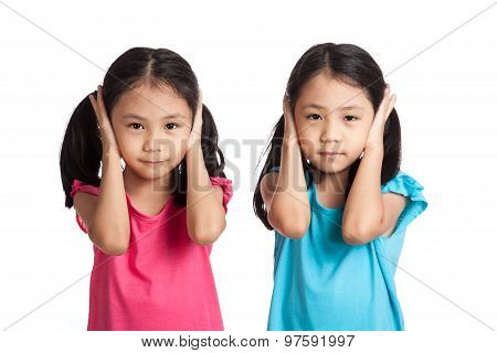 Asian Twins Girls Cover Their Ears