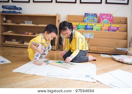 Children study and play in a kidergarten school in Hanoi, Vietnam