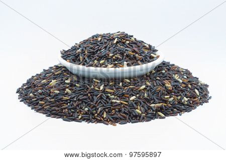 Black rice isolated on white