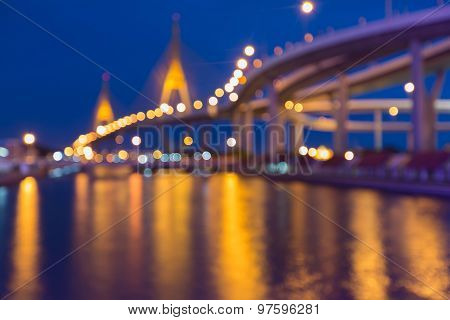 Abstract blurred bokeh light of twin suspension bridge during twilight
