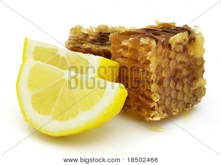 Slices of lemon with honeycombs. Use it for a health and nutrition concept.
