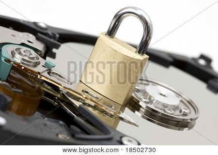 Close up of modern opened hard disk drive - a safety lock is a symbol for the security of your files