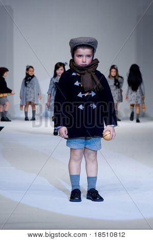 VALENCIA, SPAIN - JANUARY 23: FIMI Children's Winter Fashion Show with the designer Elisa Menuts on the runway in the Feria Valencia on January 23, 2010 in Valencia, Spain.