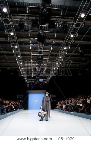 VALENCIA, SPAIN - FEBRUARY 3:  A model on the catwalk wears a Paco Roca design for the Valencia Fashion Week on February 3, 2010 in Valencia, Spain.