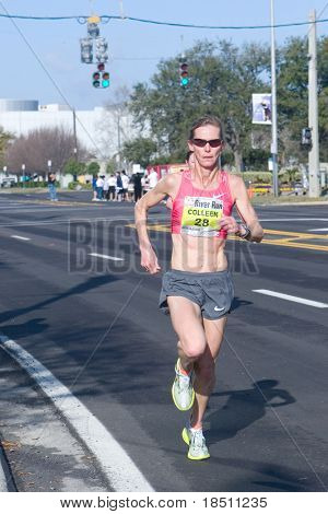 JACKSONVILLE, FLORIDA - MARCH 13: Woman runner Colleen De Reuck, age 45, of Boulder, CO competes in the 33rd Annual 15 Kilometer Gate River Run on March 13, 2010 in Jacksonville, Florida.
