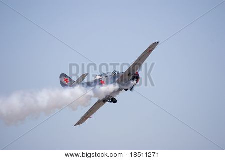 PALM COAST, FLORIDA - MARCH 27: A Soviet Union Yak 52 trainer aircraft flies at the Wings Over Flagler Air Show at the Flagler County Airport on March 27, 2010 in Palm Coast, Florida.