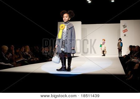 VALENCIA, SPAIN - JANUARY 22: Model Angelina Fernandez, age 12, of Valencia models in the Valencia Children's Fashion Show with the designer Barcarola on January 22, 2010 in Valencia, Spain.