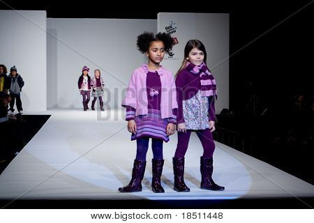 VALENCIA, SPAIN - JANUARY 23: Angelina Fernandez, age 12, and Maria Gutierrez, age 11, of Valencia in the Valencia Children's Fashion Show (designer Girandola) on January 23, 2010 in Valencia, Spain.