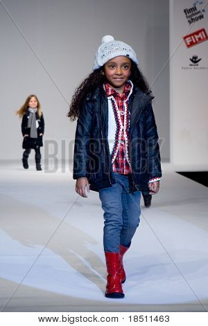 VALENCIA, SPAIN - JANUARY 23: Model Alicia Sanz, age 12, of Valencia on the catwalk for the Valencia Fashion Show with the designer Tumble'n Dry on January 23, 2010 in Valencia, Spain.