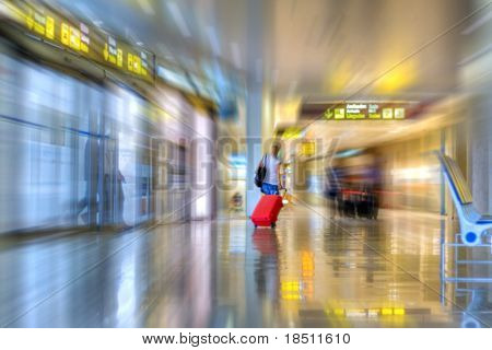 Airline passenger walking in the airport terminal