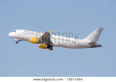 VALENCIA, SPAIN - JUNE 27: Vueling Airlines will start its new direct route from Edinburgh to Barcelona on July 1, 2010. A Vueling aircraft taking off from Valencia Airport on June 27, 2010.