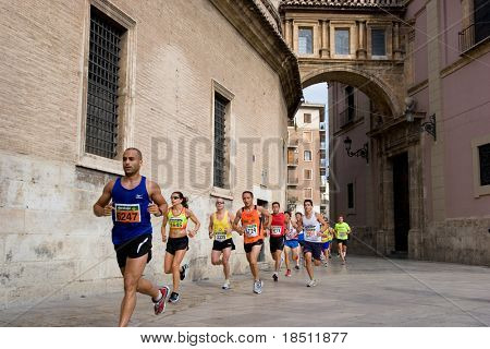 VALENCIA, SPAIN - JULY 4: Runners compete in the I Volta a Peu de les Falles de Valencia 6 km run on July 4, 2010 in Valencia, Spain.