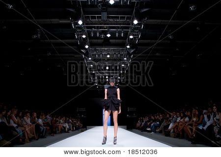 VALENCIA, SPAIN - SEPTEMBER 1: A model on the catwalk wears a Zazo & Brull design for the Valencia Fashion Week on September 1, 2010 in Valencia, Spain.