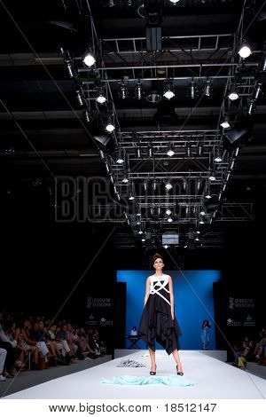 VALENCIA, SPAIN - SEPTEMBER 1: A model on the catwalk wears Tonuca design for the Valencia Fashion Week on September 1, 2010 in Valencia, Spain.