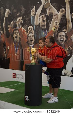 VALENCIA, SPAIN - SEPT 27: Unidentified fan holds World Cup Trophy, won by Spain in July 2010 public display at Principe Felipe Museum on September 27, 2010 in Valencia, Spain.