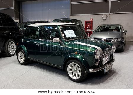 VALENCIA, SPAIN - DEC. 8: A 2001 green Mini Cooper 1300 at the Valencia Car Show on December 8, 2010 in Valencia, Spain.