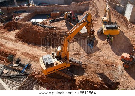Construction site with yellow tractors