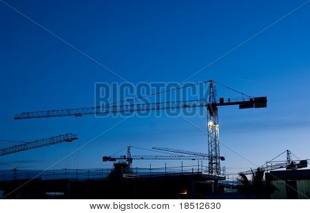 Construction cranes at work site