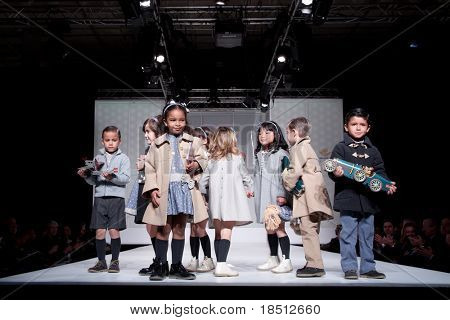 VALENCIA, SPAIN - JANUARY 21: unidentified children models at the FIMI Children's Winter Fashion Show with the designer Elisa Menuts in the Feria Valencia on January 21, 2011 in Valencia, Spain.