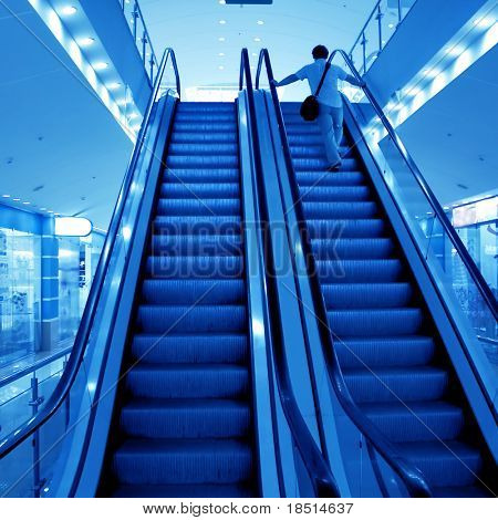 Moving escalator with stairs in airport