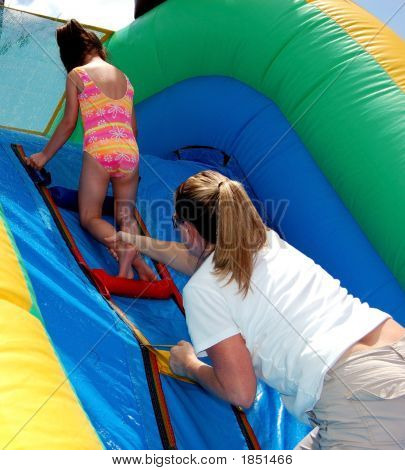 Mother And Daughter On A Water Slide