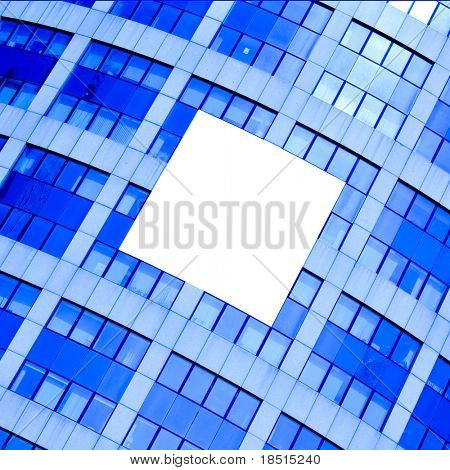 abstract crop of modern skyscraper with white placard in the center