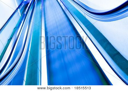 blue moving escalator in the metro station