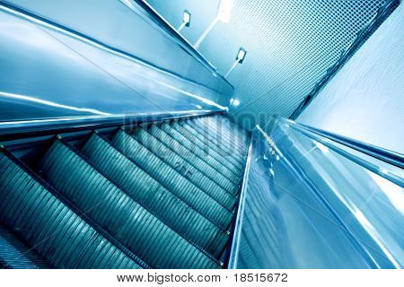 turquoise moving escalator in the metro station