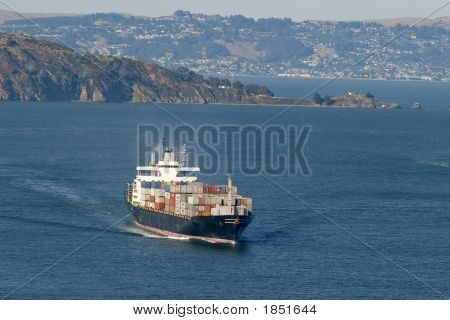Cargo Boat With Island In The Back