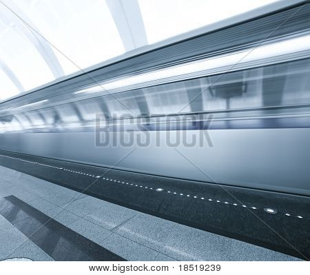 Fast moving train on underground platform