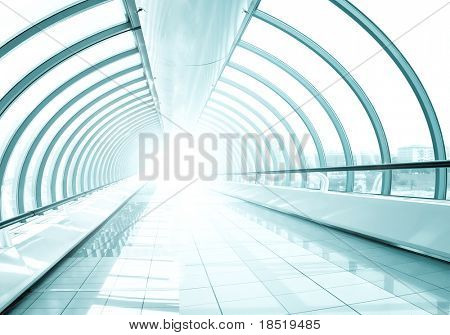 endless vanishing walkway with transparent wall in cool business center