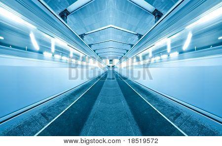 Fast moving trains on underground platform