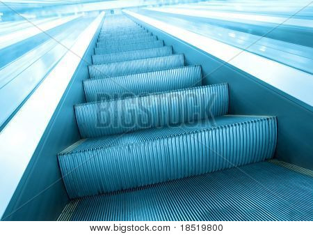 luminosity blue steps of escalator in business center